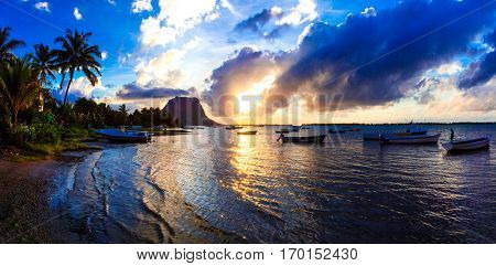 Serene tropical sunset. Mauritius island, view of Le Morne mountain
