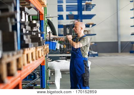 one worker in factory in stockroom- hall