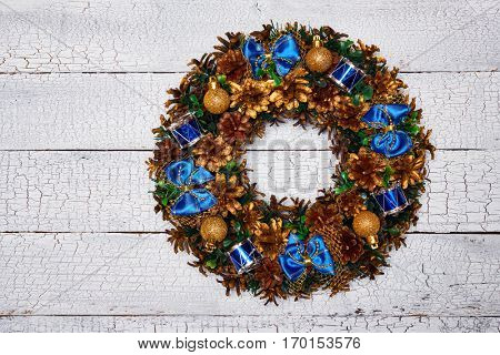 Christmas wreath on white painted wooden background