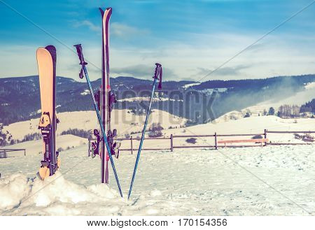 Ski Slope and the Ski Equipment. Winter Landscape in the Background.
