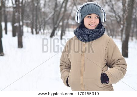 Winter Portrait Of Young Girl With Headphones
