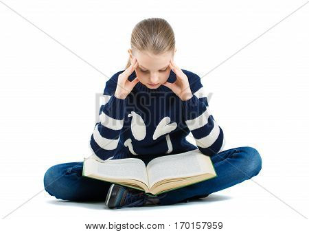 Thoughtful Girl Sitting On The Floor With A Book. Girl Holding Hands Near Head.