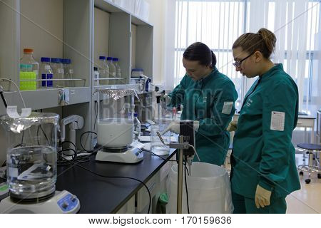 ST. PETERSBURG, RUSSIA - NOVEMBER 16, 2016: Researchers at work in the High-Throughput Biotechnology Laboratory of BIOCAD. It is one of full-cycle drug development and manufacturing companies
