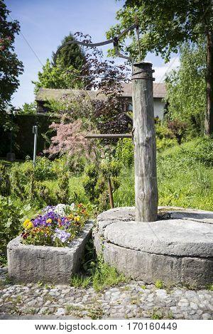 Old pump/well in a Swiss village Switzerland