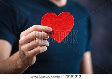 Young Funny Man With  Holding Red Heart For The Holiday
