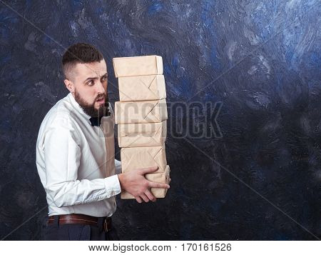 Young Funny Man With Gift Is Preparing For The Holiday 16