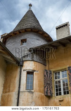 mountain village of Romainmotier-Envy old medieval house with tower - Switzerland