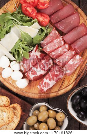 Charcuterie board with italian style cured meat deli