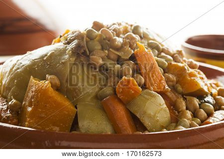 Traditional Moroccan dish with couscous close up on white background