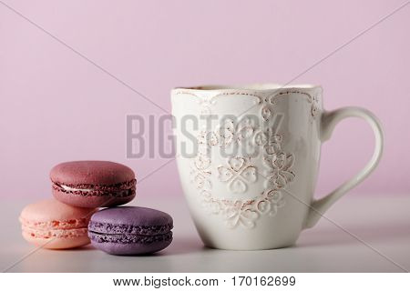 cup with macaroons