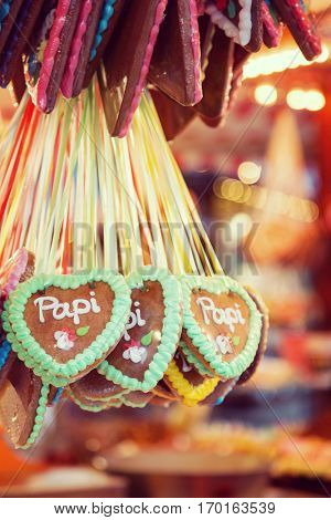 German gingerbread for sale at a Christmas street market in Berlin. Papi is german for Dad.