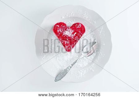 Pastry heart with jelly on white plate