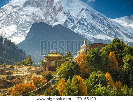 Himalayas mountain landscape. Buddhist monastery and Manaslu mount in Himalayas, Nepal. View from Manaslu circuit trek
