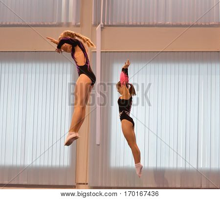 Orenburg, Russia December 4, 2016: Girls Compete In Synchronous Jumping On A Trampoline