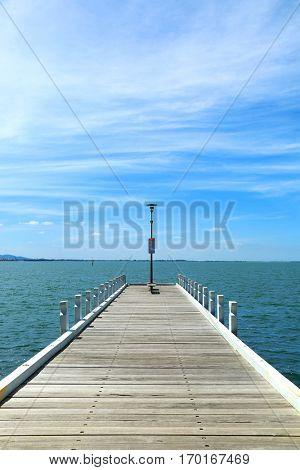 Wooden pier into the sea in Australia