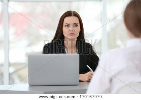 Job interview concept. Human resources manager interviewing woman