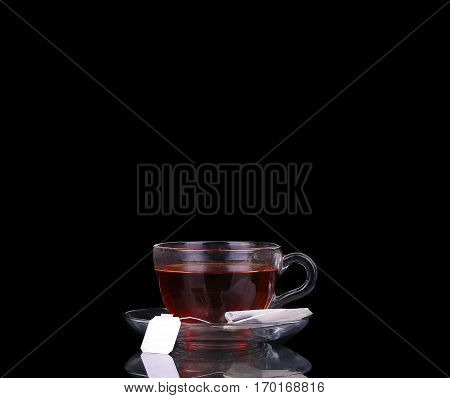 Glass Cup On Black. Tea Bag. Boiling Water.
