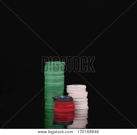 The white black red and green chip isolated on white background.