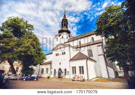TALLINN ESTONIA - JULE 29 2013: Old town Tallinn with St. Nicholas church in summer morning