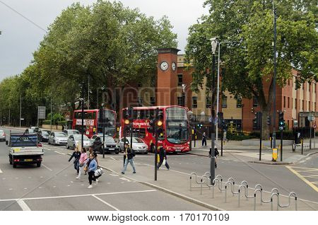 LONDON UK - SEPTEMBER 17 2016: Pedestrians crossing the road at Seven Sisters in the borough Haringey North London. Viewed on an overcast Saturday afternoon in early autumn.