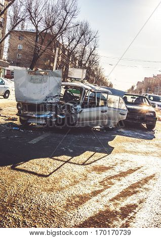 Auto accident involving two cars on a city street. Car crash. Vertical image