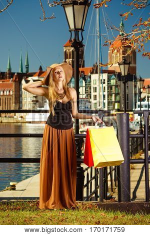 Fashionable Woman Walking With Shopping Bags