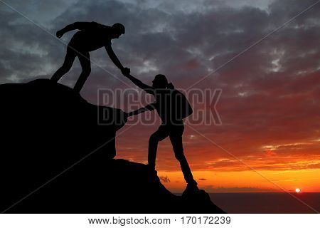 Teamwork Couple Hiking Help Each Other Trust Assistance Silhouette In Mountains, Sunset. Teamwork Of