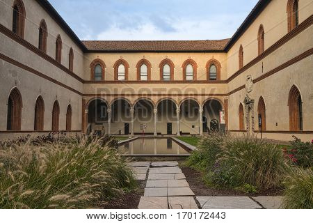 MILAN, ITALY - OCTOBER 10, 2016: Milan (Lombardy Italy): the medieval castle known as Castello Sforzesco: a court with water and portico