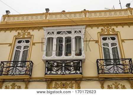 Ronda (Andalucia Spain): facade of old typical building with balconies and veranda