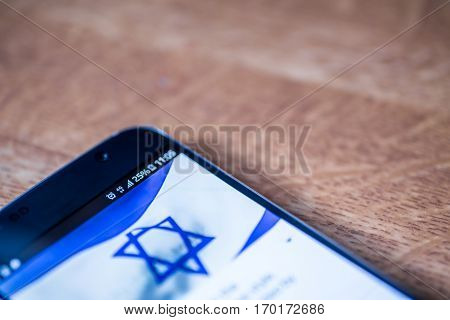 Smartphone With 25 Percent Charge And Israel Flag