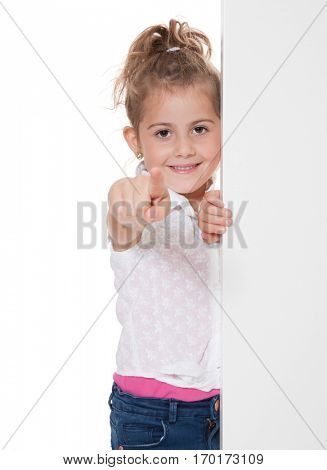 Young girl pointing with finger