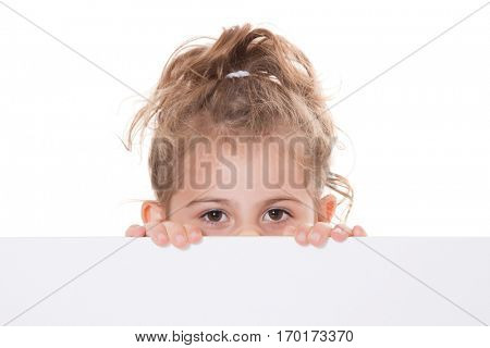 Young girl hiding behind white placeholder