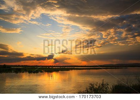 sunset in the river with reflex and red sky