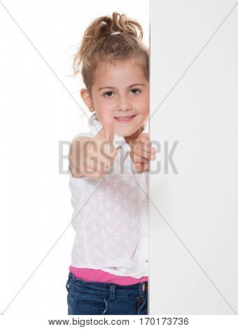 Young girl showing thumbs up