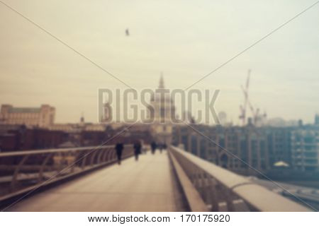 Defocused background of people on millennium bridge and St. Paul Cathedral in London