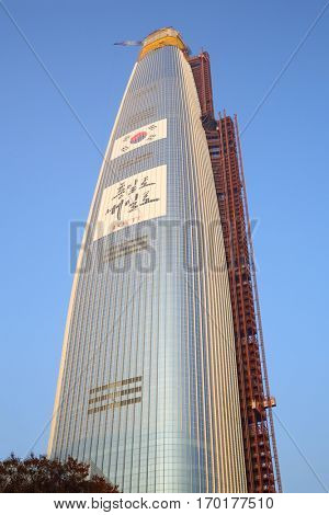 SEOUL - NOV 3, 2015: Lotte World Tower and Mall, According to project building height will be 555 meters, making it one of tallest buildings in world