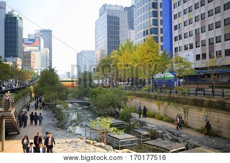 SEOUL - NOV 3, 2015: Han river, people and skyscrapers. Seoul City Hall has published plan for integrated development of area of Han River