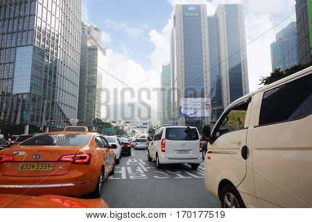 SEOUL - NOV 3, 2015: Taxi and other cars driving on street near buildings. In Seoul pledged to limit advertising of cosmetic surgery