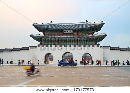 SEOUL - NOV 2, 2015: Street with cars near exit to Gyeongbokgung with pagoda. Seoul hosted phantom protest against background of ancient palace of Gyeongbokgung