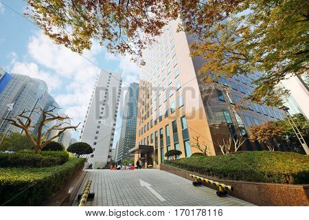 SEOUL - NOV 3, 2015: Ground and bushes near highrise building. In Seoul was Turkmen-Korean business forum dedicated gas potential and investment opportunities