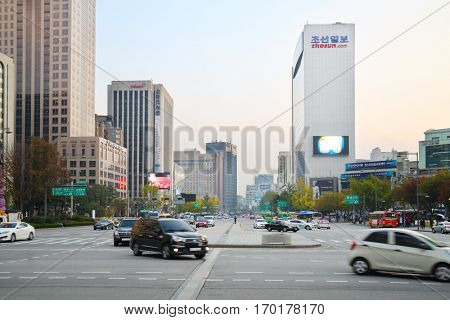 SEOUL - NOV 2, 2015: Wide avenue Sejong with driving cars, buses and highrise building among. South Korea is implementing road signs for dependent smartphones