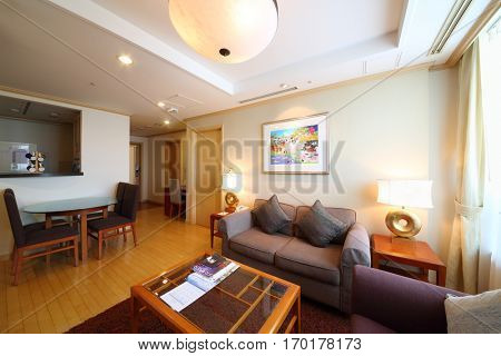 SEOUL - NOV 2, 2015: Room with sofa, tables and exit door in hotel Fraser Insadong