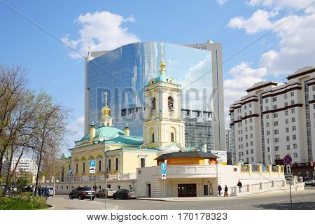 MOSCOW, RUSSIA - APR 28, 2016: Church of Transfiguration Savior and business centre PREO8