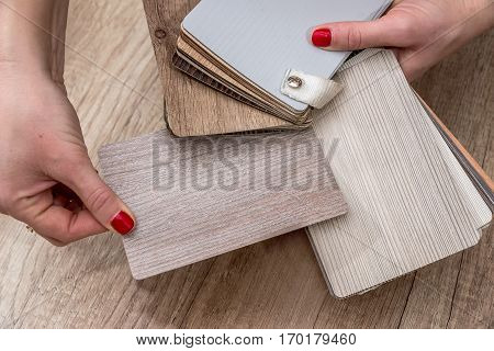 woman hold wooden color guide close up