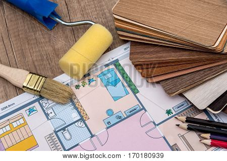 individual plan of house with wooden samples pencil on desk.