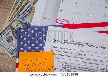 text tax time on tax form with flan money and calculator.