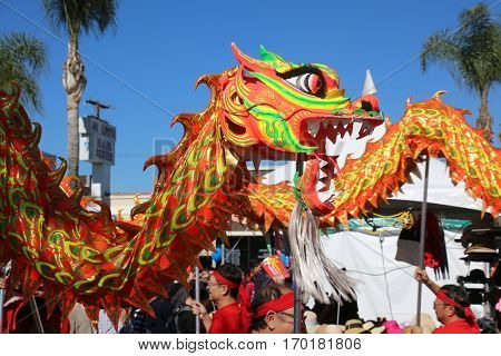 MONTERY PARK CA - JANUARY 28: Chinese New Year Parade in Chinatown. Dragon dancers celebrate the Lunar New Year of the Rooster starting January 28, 2017 through February 11, 2017.