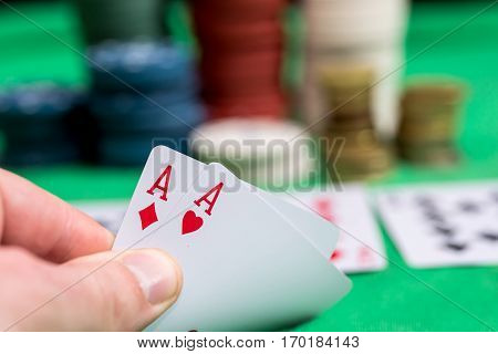 Woman in casino with two aces close up