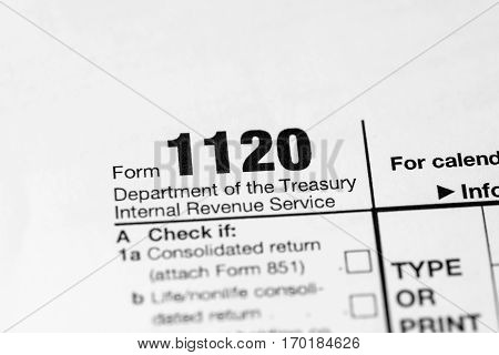 US 1120 tax form close up .