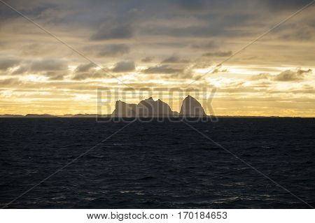 Norwegian landscape view of the Traena and Sana islands under midnight sun Norway